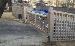 Wooden slide gate fastened to aluminum track