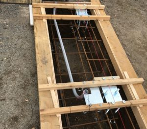 Reinforced foundation frame with J-Bolts tie rods to hold carriage foundation plates, conduit to run power to the gate operator.