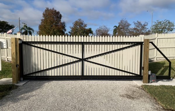 Residential Wood Picket Cantilever Gate in Naples, Florida