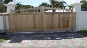 Wooden cantilever gate with arched top in Bermuda