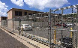 apartment parking lot with sliding gate