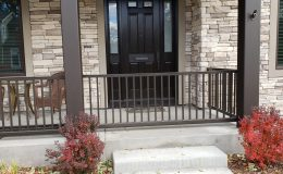 closed sliding gate on porch